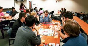 Campus MPH students play Monopoly.